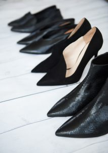 Row of smart black shoes
